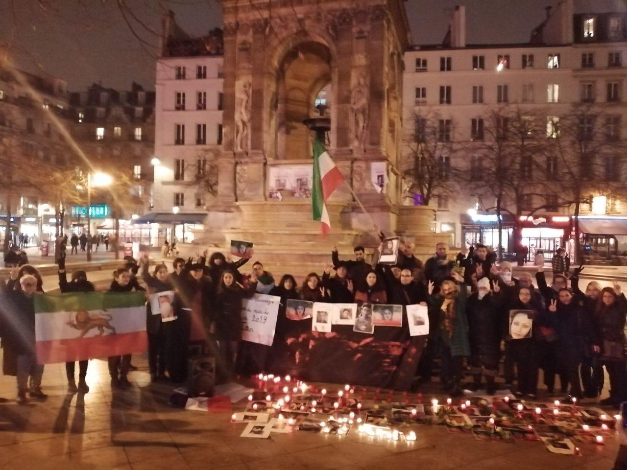 سخنرانی فرهنگ قاسمی در میدان بیگناهان پاریس در دفاع از بیگناهان کشته شده، زندانی و مفقود شده در آبانماه در ایران